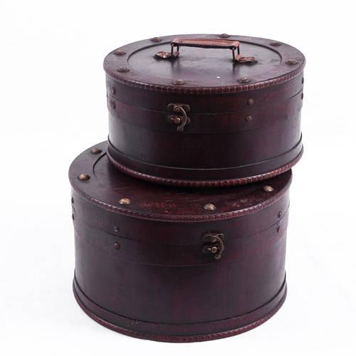 Scatola tonda cappelliera legno noce con maniglia ecopelle